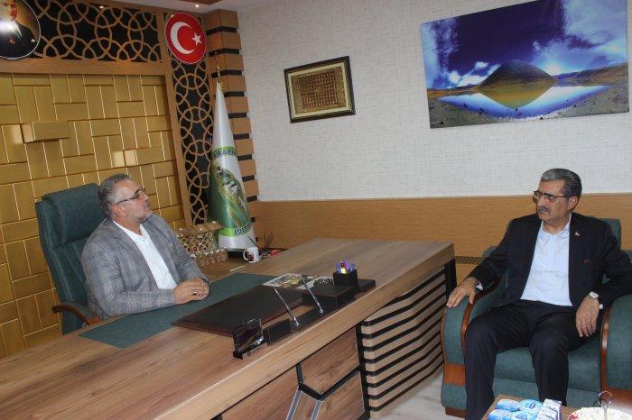Konuk, Başkan Mehmet Tartan'ı ziyaret etti
